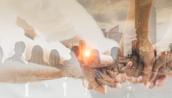 Double exposure panoramic teamwork business join hand together with silhouette business people and modern city background. Business team standing hands together, Volunteer charity work.